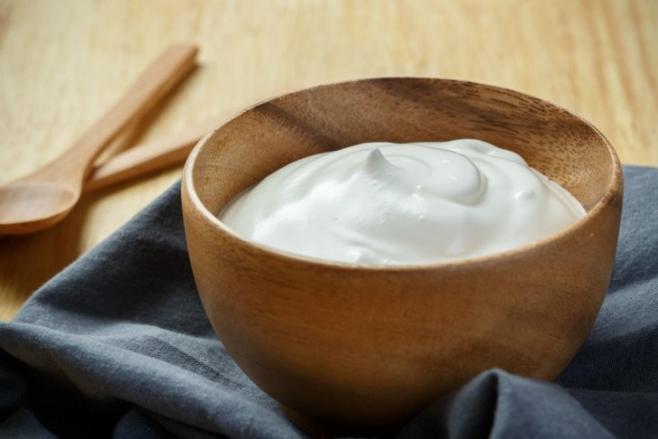 Yogurt-in-wooden-bowl-on-wooden-background-with-blue-cotton-and-wooden-spoon.-plain-yoghurt.-yogurt.-yoghurt..jpg